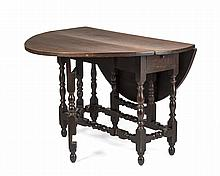 FINE WILLIAM AND MARY BROWN-STAINED MAPLE OVAL-TOP GATE-LEG TABLE, NEW ENGLAND, PROBABLY MASSACHUSETTS, CIRCA 1730.
