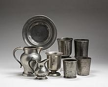 GROUP OF ENGLISH OR CONTINENTAL PEWTER WARES INCLUDING CUPS AND BEAKERS, A PITCHER, A SMALL CREAMER AND A PLATE.