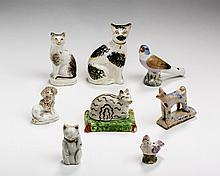 EIGHT ENGLISH EARTHENWARE AND PORCELAIN TOY FIGURES AND WHISTLES, NINETEENTH CENTURY.