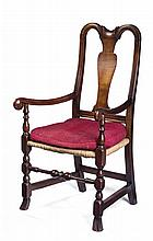 MASSACHUSETTS QUEEN ANNE CARVED-MAPLE ARMCHAIR WITH SPANISH FEET.