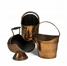 GEORGE III BRASS AND COPPER BUCKET WITH BAIL HANDLE AND A VICTORIAN COPPER COAL BUCKET WITH TURNED WOODEN HANDLE, THE UNDERSIDE INDISTINCTLY STAMPED.