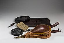 TWO CARVED, TURNED AND EBONIZED-WOOD TREEN HAND MIRRORS, NINETEENTH CENTURY.