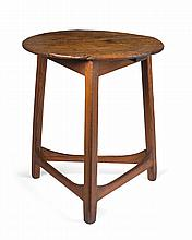PINE TAVERN TABLE WITH CIRCULAR TOP AND TRIANGULAR BASE.
