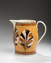 RARE BRITISH CREAMWARE MOCHAWARE 'DIPPED FAN' PATTERN JUG, CIRCA 1810.