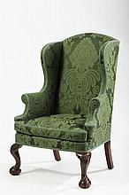 FINE AND RARE CHIPPENDALE CARVED-MAHOGANY BALLOON-SEAT WING CHAIR, NEW YORK, CIRCA 1760.