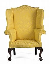 RARE AND IMPORTANT CHIPPENDALE CARVED-MAHOGANY WING CHAIR IN OLD SURFACE, PHILADELPHIA, PENNSYLVANIA, CIRCA 1770.