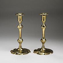 PAIR OF GEORGE II/III BRASS SWIRL-BASE CANDLESTICKS, 1750-60.