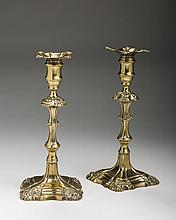 PAIR OF GEORGE II/ III BRASS CANDLESTICKS OF SILVER FORM, CIRCA 1750.
