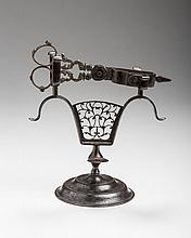 PAIR OF ENGLISH ENGRAVED POLISHED STEEL WICK TRIMMERS, AND STAND SIGNED MORTON, CIRCA 1825.