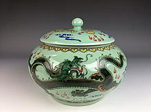 Chinese porcelain pot with lid, famille rose glazed on green ground