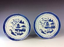 Pair of Chinese export blue and white porcelain plates with landscaping.