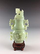 Chinese carved jade covered censer. with foo dog finial. comes on fitted base.