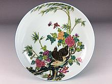 Rare Chinese porcelain plate, famille rose glazed with blue glaze at bottom, marked