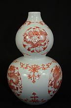 Chinese uncerglazed red porcelain vase, decorated with dragons, marked