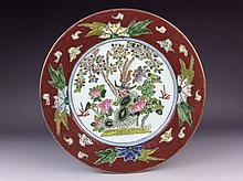 Chinese export porcelain plate painted with phoenix and flower, marked on base.