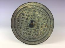 Chinese bronze mirror.