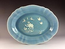 Fine Chinese porcelain plate, white decoration on blue glaze