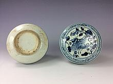 Chinese blue and white porcelain round box decorated with phoenix and floral design.