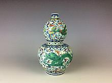 Chinese blue and white with overglaze colours porcelain double gourd bottle with dragon and phoenix motif, six character mark on base.