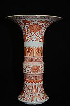 Chinese white ground porcelain with iron red and gilt foliage decoration,  marked
