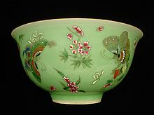 Beautiful Chinese Celadon glazed bowl decorated with famille rose butterflies.