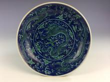 Late Qing period, 19C, Fine Chinese porcelain blue ground with yellow glazed dragon plate, marked