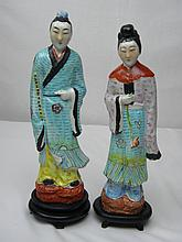 PAIR OF ANTIQUE FAMILLE ROSE MAN AND LADY
