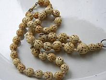 CHINESE CARVED FAUX IVORY OR BONE NECKLACE