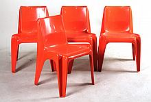 Four Orange Plastic Stackable Chairs