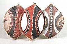 Three Painted Decorative Shields