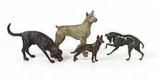 Four Bronze Standing Dog Figures