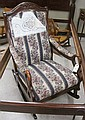 EMPIRE STYLE MAHOGANY SWAN-ARM ROCKING CHAIR,