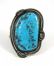 NAVAJO TURQUOISE AND SILVER CUFF BRACELET.  The ha