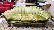 A CARVED AND GREEN UPHOLSTERED SOFA, American, c.
