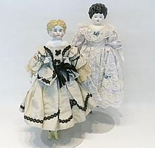 TWO CHINA HEAD SHOULDER DOLLS, one with molded blo