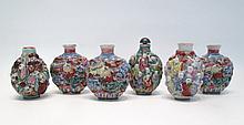 SIX CHINESE MOLDED PORCELAIN SNUFF BOTTLES depicti