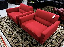 A PAIR OF RED MID-CENTURY MODERN STYLE LOUNGE CHAI
