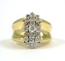DIAMOND AND FOURTEEN KARAT GOLD CLUSTER RING, set