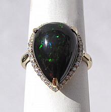 BLACK OPAL AND FOURTEEN KARAT GOLD RING, with roun