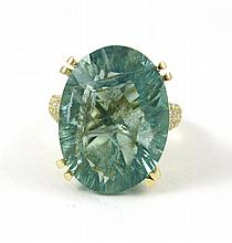 GREEN FLUORITE AND FOURTEEN KARAT GOLD RING, with