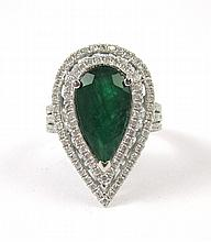 EMERALD, DIAMOND AND FOURTEEN KARAT GOLD RING. The