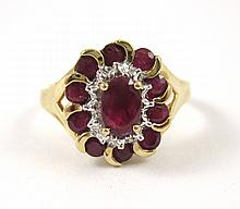 RUBY AND FOURTEEN KARAT GOLD RING. The yellow and