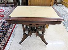 A VICTORIAN WALNUT LAMP TABLE, American, 19th cent