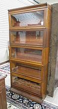 A STACKING OAK BOOKCASE, American, c. 1910, having