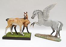 TWO BISQUE PORCELAIN HORSE FIGURES, the Pegasus  m