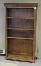 AN OAK OPEN-SHELF BOOKCASE, American antique repro