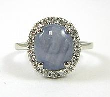 STAR SAPPHIRE AND DIAMOND RING, 14k white gold wit