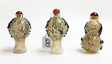 THREE CHINESE AGATE SNUFF BOTTLES, various oval  f