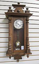 A WALNUT CASED R&A; WALL CLOCK, attributed to the K