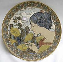 METTLACH ETCHED POTTERY PLAQUE, #2545, Art Nouveau Girl's Portrait, signed R. Fournier.  Mettlach trademark underfoot, 1885-1930.  Diameter 20 inches.